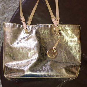Michael Kors shiny gold purse